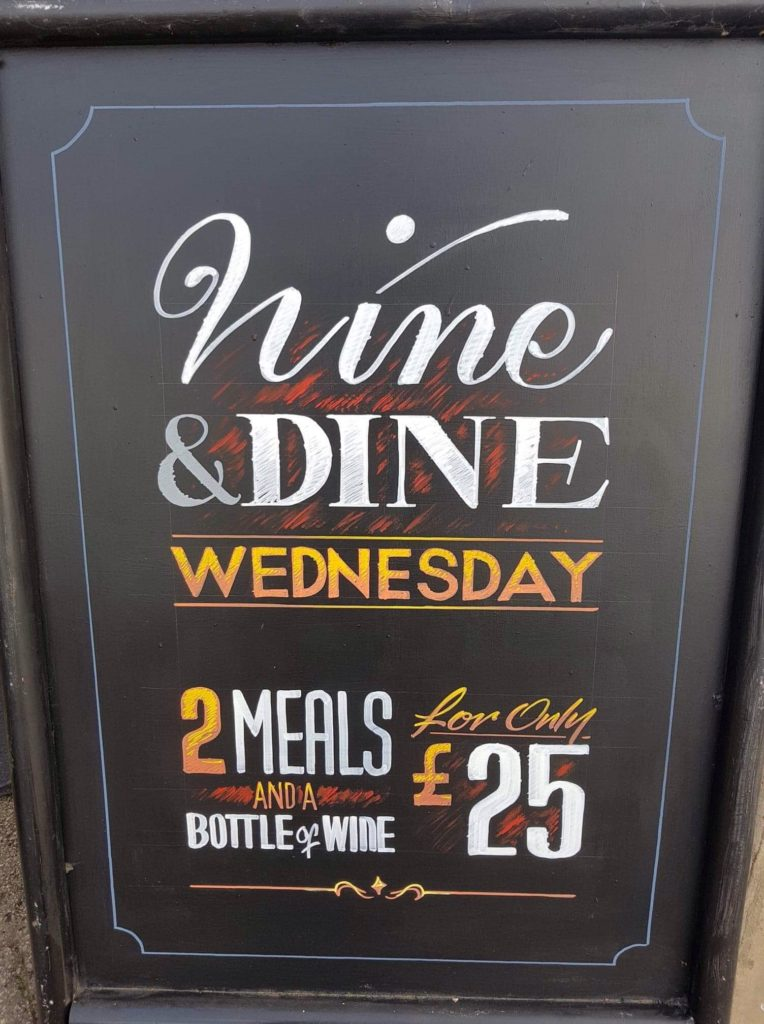 Chalkboard with Wednesday night wine offer at the Victoria Pub Allerton Bywater